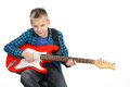 Handsome young boy playing on red electric guitar white background Stock Photos