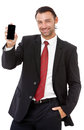 Handsome young business man talking on the phone a against a white background Royalty Free Stock Photos