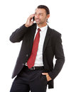 Handsome young business man talking on the phone a against a white background Stock Image