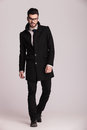 Handsome young business man wearing a long black coat Royalty Free Stock Photo