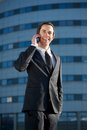 Handsome young businessman calling by mobile phone portrait of a outside the office Royalty Free Stock Photography