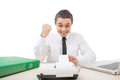 Handsome young businessman happy and joyful man sitting at desk working hard Stock Photos
