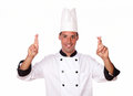 Handsome young chef crossing his fingers Royalty Free Stock Photography