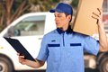 Handsome young delivery man carrying carton box Royalty Free Stock Photo