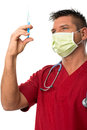 Handsome young doctor with mouth mask, stethoscope Royalty Free Stock Photo