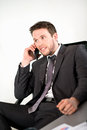 Handsome young executive business man in office Stock Photo