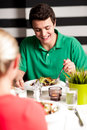 Handsome young guy enjoying his meal focused image of a in a restaurant Royalty Free Stock Image