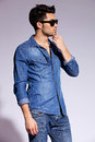 Handsome young male model wearing jeans shirt Royalty Free Stock Image