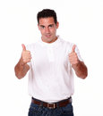 Handsome young male with ok sign portrait of a on white t shirt standing and smiling at you on isolated background Stock Photography