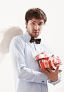 Handsome young man as cupid angel with presents Royalty Free Stock Photo