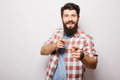Handsome young man with beard demonstrate  invisible product presentation or advertising  pointed with hands Royalty Free Stock Photo