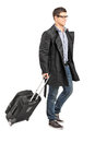 Handsome young man carrying his luggage isolated on white background Royalty Free Stock Photography