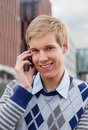 Handsome young man with cellphone Stock Images