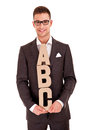 Handsome young man in classic suit and with letters abc business writing coaching concept bussiness over white background Stock Image