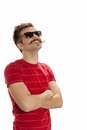 Handsome young man with crossed arms standing and smiling isol happy hipster sunglasses crosses his looks up smiles isolated on Royalty Free Stock Photography