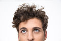 Handsome young man with curly hair looking up crop image of a at copyspace Royalty Free Stock Photo