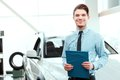 Handsome young man in dealership Royalty Free Stock Photo