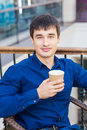 Handsome young man drinking coffe in a restaurant break time Royalty Free Stock Images