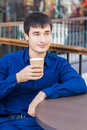 Handsome young man drinking coffe in a restaurant break time Stock Photos