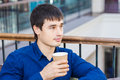 Handsome young man drinking coffe in a restaurant break time Stock Photography