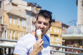 Handsome young man eating ice cream on the street in Venice Royalty Free Stock Photo