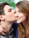 Handsome young man embracing his girlfriend with love very men Stock Images