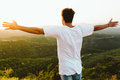 Handsome young man enjoying nature at mountain peak. Royalty Free Stock Photo