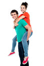 Handsome young man giving a piggyback ride Royalty Free Stock Images