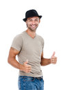 A handsome young man giving you the thumbs up smiling against white background Royalty Free Stock Photos
