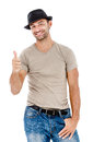 A handsome young man giving you the thumbs up smiling against white background Royalty Free Stock Image