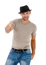 A handsome young man giving you the thumbs up smiling against white background Stock Photography