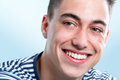 Handsome young man with healthy teeth looking aside macro face portrait of Royalty Free Stock Photo