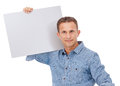 A handsome young man holding a placard over white background Stock Images
