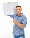 A handsome young man holding a placard over white background Royalty Free Stock Photography