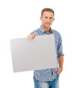 A handsome young man holding a placard over white background Royalty Free Stock Image