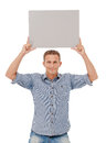 A handsome young man holding a placard over white background Stock Photo