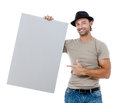 A handsome young man holding a placard smiling isolated on white background Royalty Free Stock Photography