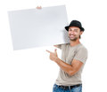 A handsome young man holding a placard smiling isolated on white background Royalty Free Stock Photos