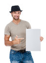 A handsome young man holding a placard smiling isolated on white background Stock Photo