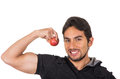 Handsome young man holding red apple closeup athletic latin showing muscles isolated on white Royalty Free Stock Photo