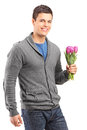 Handsome young man holding tulips Stock Image