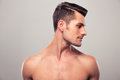 Handsome young man looking away over gray background Royalty Free Stock Image