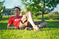 Handsome young man lying on the grass Royalty Free Stock Photography