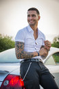 Handsome young man next to car in white shirt Royalty Free Stock Photo