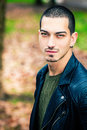 Handsome young man outdoors, short hair style Royalty Free Stock Photo