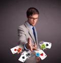 Handsome young man playing poker cards chips Royalty Free Stock Images