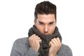 Handsome young man posing with gray wool scarf Royalty Free Stock Photo