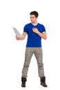 Handsome young man reading document in blue shirt full length studio shot isolated on white Stock Photography