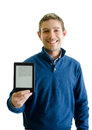 Handsome young man showing ebook reader with e in his hand smiling isolated on white Royalty Free Stock Photography