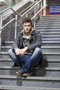 Handsome young man sitting on stairs Stock Photography
